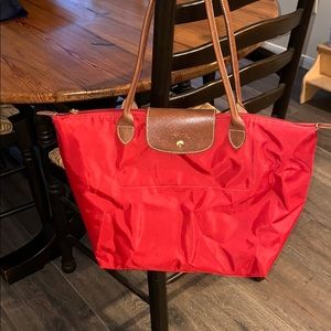 Longchamp Le Pliage in bright red